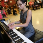 Akela play piano at senior home